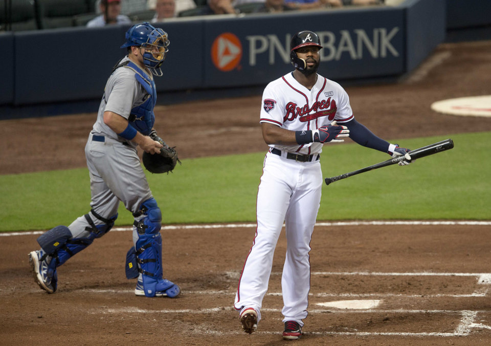 Photo - Atlanta Braves' Jason Heyward reacts after striking out to end the fourth inning as Los Angeles Dodgers catcher A.J. Ellis (17) looks n of a baseball game  Monday, Aug. 11, 2014 in Atlanta.  (AP Photo/John Bazemore)