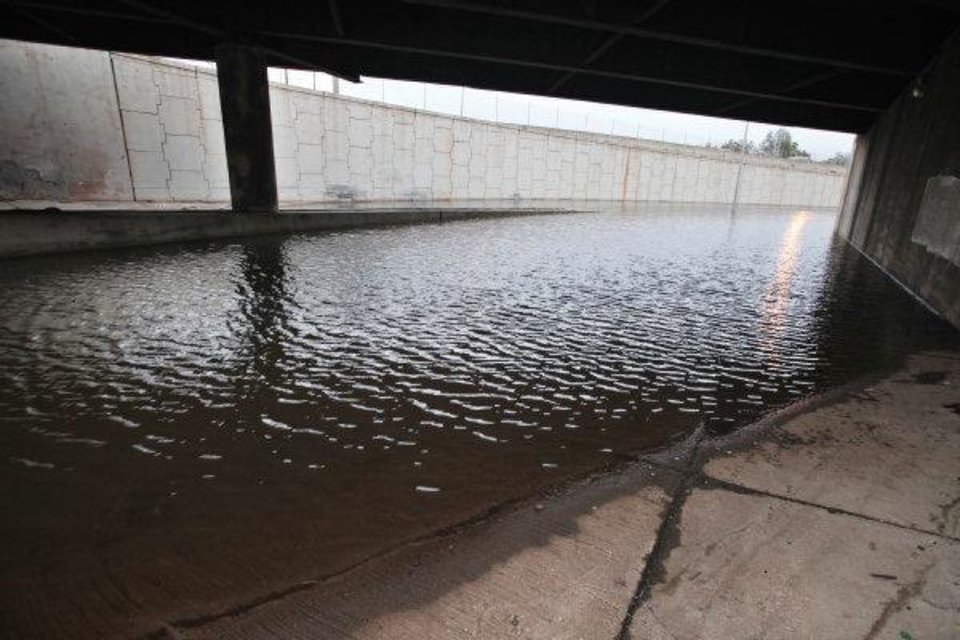 Photo - The westbound off-ramp and eastbound on-ramp to I-44 were closed at Classen Boulevard due to flooding from weekend rains in Oklahoma City Monday   PAUL B. SOUTHERLAND - PAUL B. SOUTHERLAND
