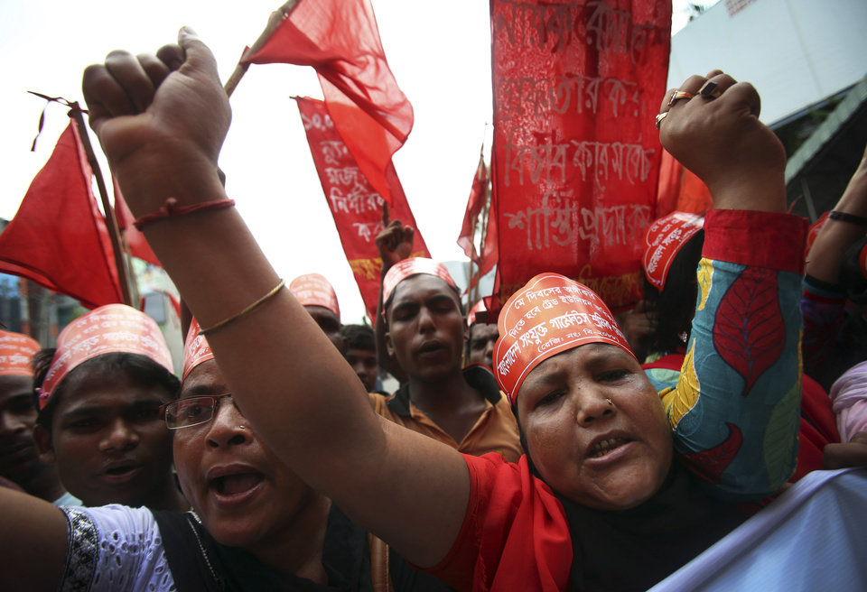 Protestors shout slogans during a May Day rally on Wednesday May 1, 2013 in Dhaka, Bangladesh. Thousands of workers paraded through central Dhaka on May Day to demand safer working conditions and the death penalty for the owner of a building housing garment factories that collapsed last week in the country\'s worst industrial disaster, killing at least 402 people and injuring 2,500. (AP Photo/Wong Maye-E)