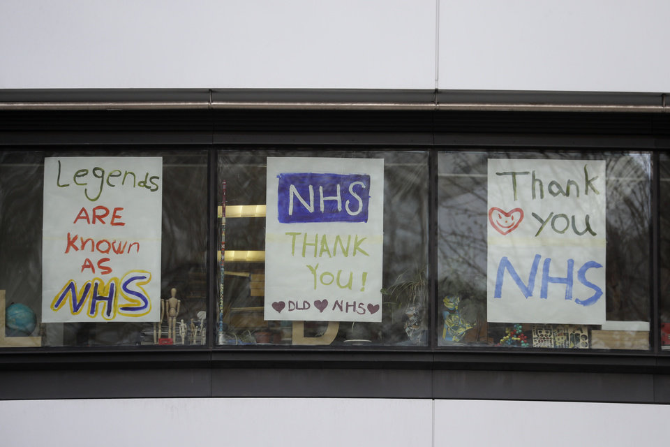 Photo -  Signs in support of the British National Health Service staff who are fighting the coronavirus outbreak put up by students at the DLD College neat St Thomas' Hospital in London, Tuesday, March 31, 2020. The new coronavirus causes mild or moderate symptoms for most people, but for some, especially older adults and people with existing health problems, it can cause more severe illness or death.(AP Photo/Kirsty Wigglesworth)