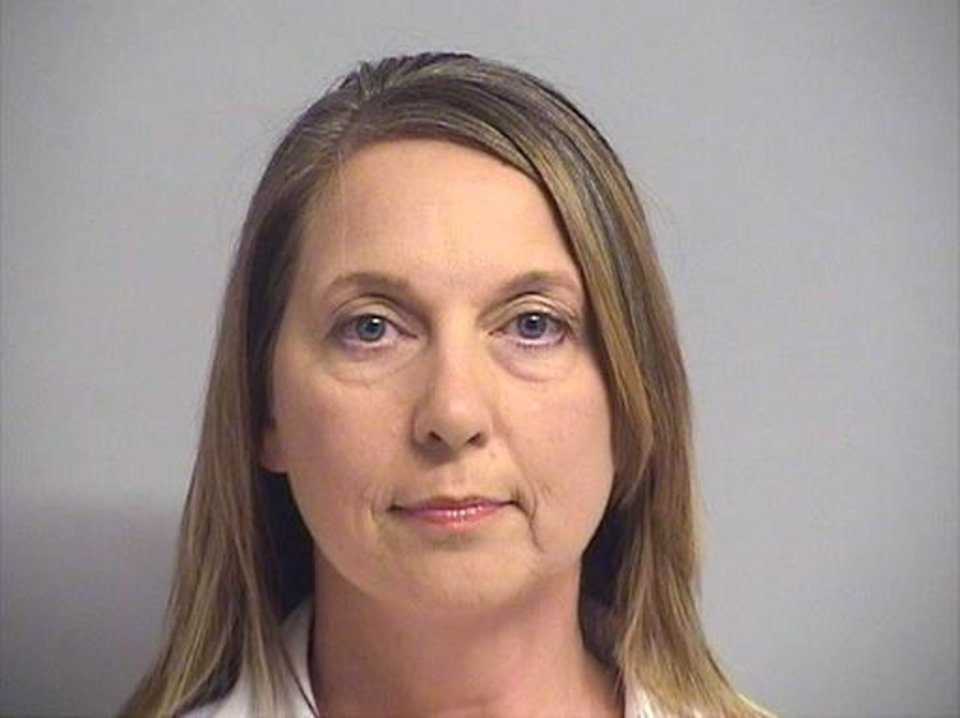 Photo - This photo provided by Tulsa County Inmate Information Center shows Tulsa police officer Betty Shelby. Tulsa County jail records show that Shelby turned herself in early Friday, Sept. 23, 2016, hours after prosecutors charged her with first-degree manslaughter in the death of Terence Crutcher. (Tulsa County Inmate Information Center via AP)