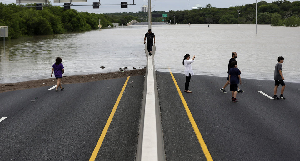 Photo - Flood waters cover eight lanes of Highway 281, Saturday, May 25, 2013, in San Antonio.  The San Antonio International Airport by Saturday afternoon had recorded nearly 10 inches of rain since midnight.  (AP Photo/Eric Gay)