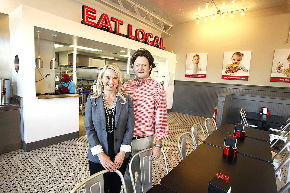Photo - Owners Heather and Keith Paul stand at Tucker's Onion Burgers on NW 23. Photo by Paul B. Southerland, The Oklahoman Archives