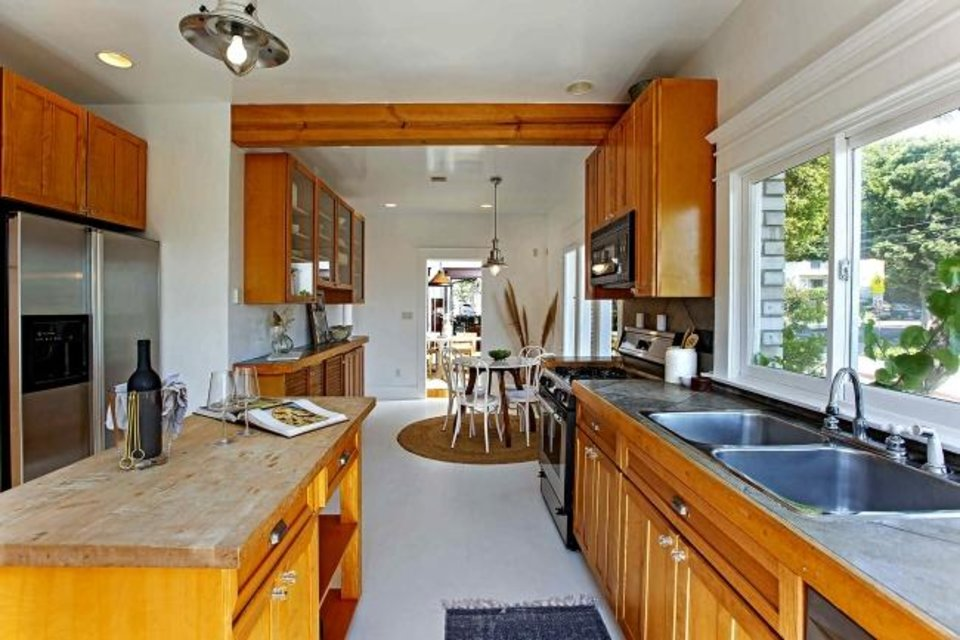 Photo -  Will Forte's home features a galley-style kitchen and a breakfast room. [TNS PHOTO]