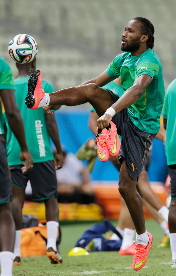 Photo - Ivory Coast's Didier Drogba controls a ball during on official training session the day before the group C World Cup soccer match between Greece and Ivory Coast at the Arena Castelao in Fortaleza, Brazil, Monday, June 23, 2014. Ivory Coast should beat Group C strugglers Greece, but even a draw won't hold them back as long as Japan doesn't upset Colombia. (AP Photo/Fernando Llano)