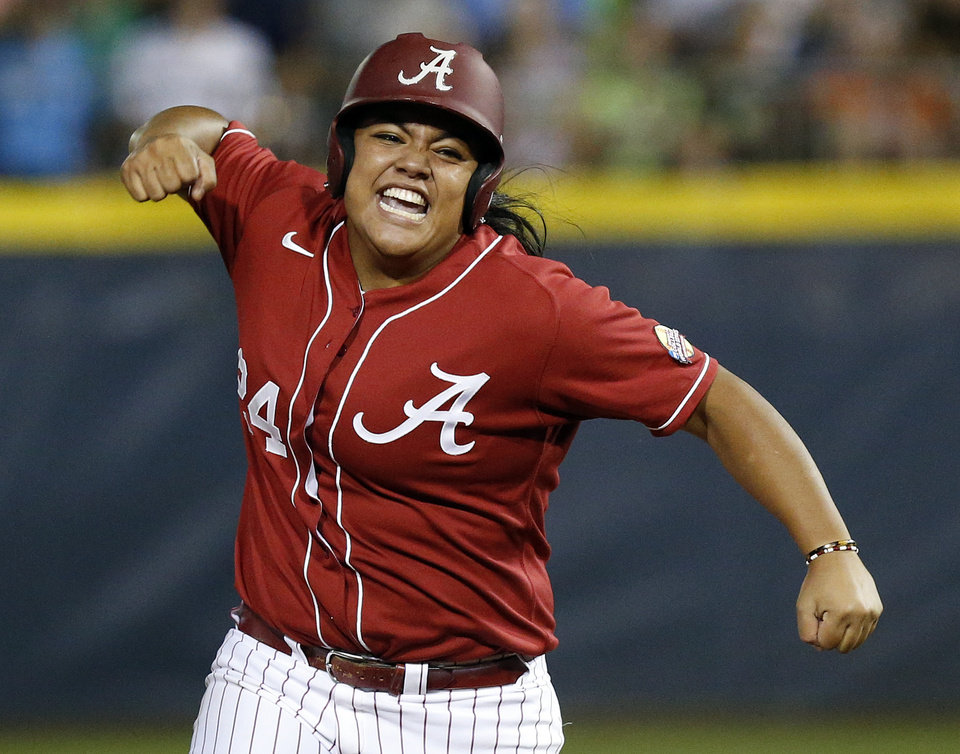 Photo - Alabama's Leona Lafaele (24) reacts as she runs the bases after hitting a 2-run home run in the 2nd inning during Game 6 of the Women's College World Series softball tournament between Alabama and Kentucky at ASA Hall of Fame Stadium in Oklahoma City, Friday, May 30, 2014. Alabama won, 2-0. Photo by Nate Billings, The Oklahoman