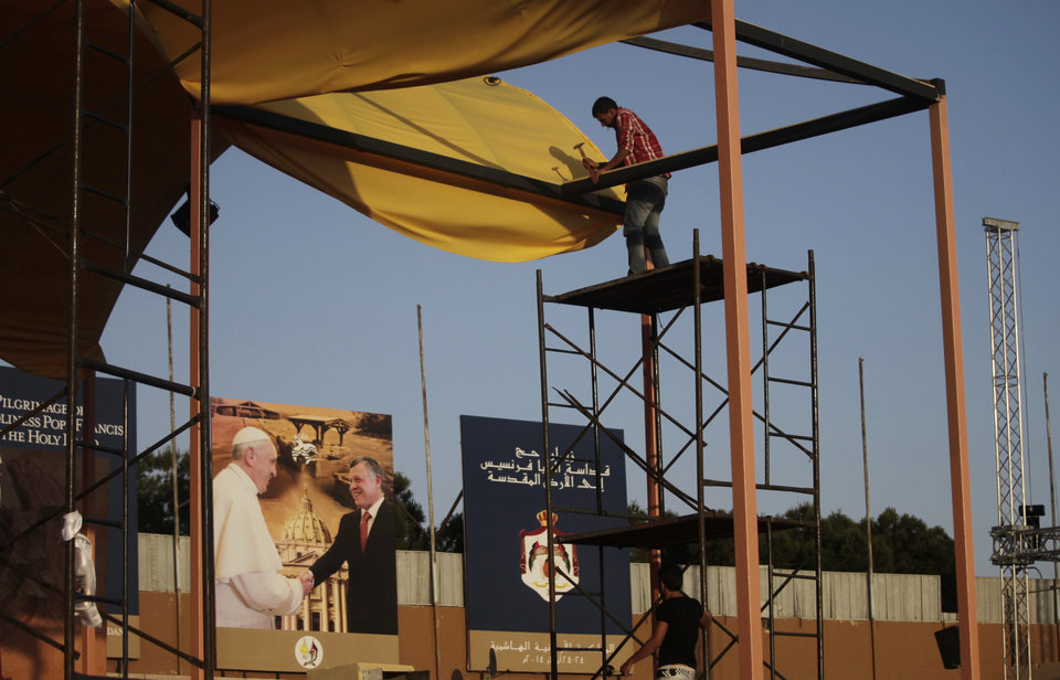 Photo - In this Thursday, May 22, 2014 photo, workers make final preparations ahead of Saturday's mass that will be conducted by Pope Francis at  Amman International Stadium in Jordan.(AP Photo/Mohammad Hannon)