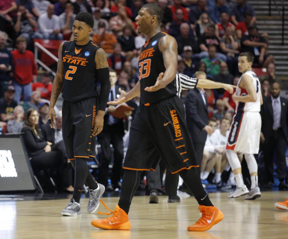 Photo - Oklahoma State's Le'Bryan Nash (2) and Marcus Smart (33) react after Nash fouled out during a second round game of the NCAA men's college basketball tournament at Viejas Arena in San Diego, between Oklahoma State and Gonzaga Friday, March 21, 2014. Gonzaga won 85-77. Photo by Bryan Terry, The Oklahoman