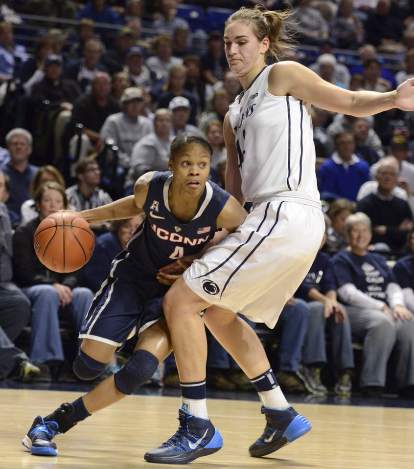 Photo - Connecticut's Moriah Jefferson (4) drives to the basket past Penn State's Tori Waldner, right, during the first half of an NCAA college basketball game, Sunday, Nov. 17, 2013, in State College, Pa. (AP Photo/John Beale)