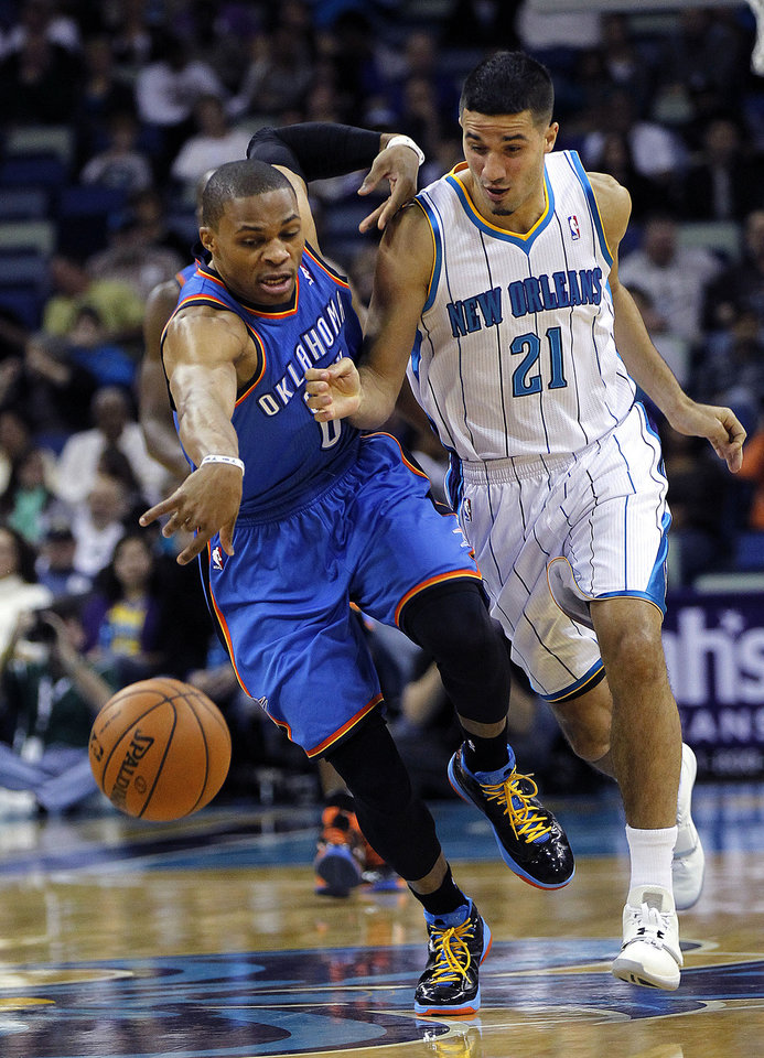 Oklahoma City Thunder guard Russell Westbrook (0) steals the ball from New Orleans Hornets guard Greivis Vasquez (21) as Vasquez fouls him in the first half of an NBA basketball game in New Orleans, Saturday, Dec. 1, 2012. (AP Photo/gerald herbert)