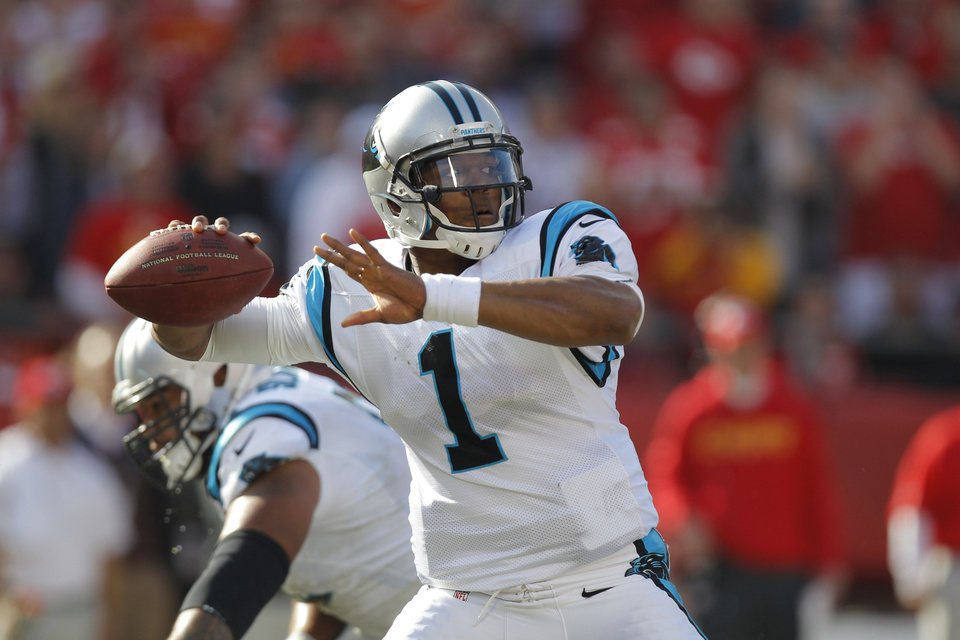 Photo - FILE - In this Dec. 2, 2012, file photo, Carolina Panthers quarterback Cam Newton throws a pass during the first half of an NFL football game against the Kansas City Chiefs at Arrowhead Stadium in Kansas City, Mo. Newton has thrown 151 consecutive passes without an interception, currently the longest streak in the league. (AP Photo/Ed Zurga, File)