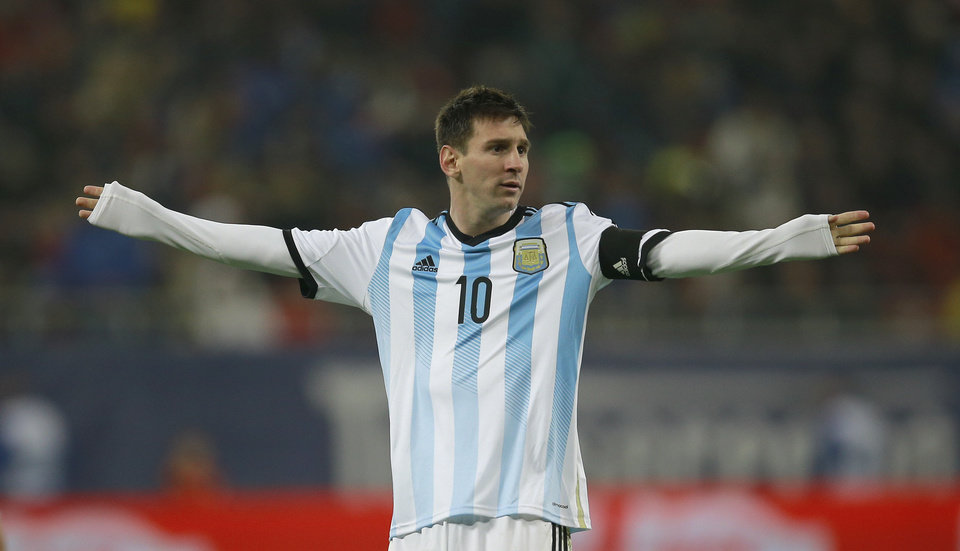 Photo - Argentina's Lionel Messi reacts during an international friendly soccer game against Romania on the National Arena stadium in Bucharest, Romania, Wednesday, March 5, 2014.. (AP Photo/Vadim Ghirda)