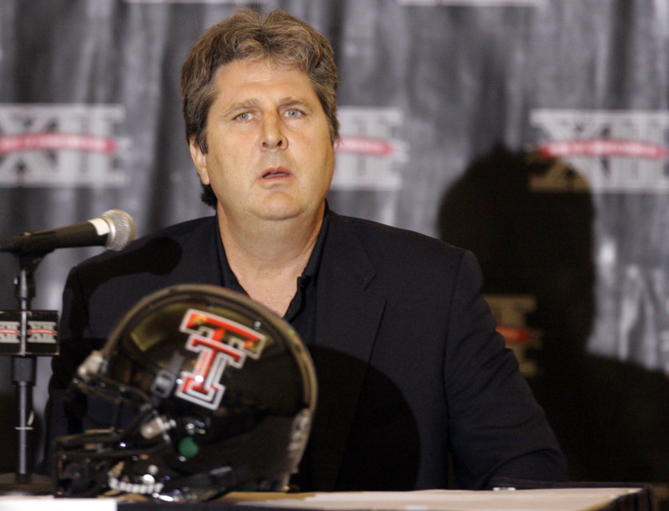 Photo - COLLEGE FOOTBALL: Texas Tech University coach Mike Leach listens to a reporter's question during Big 12 Football Media Days in Kansas City, Mo., Monday, July 21, 2008. (AP Photo/Orlin Wagner) ORG XMIT: MOOW106