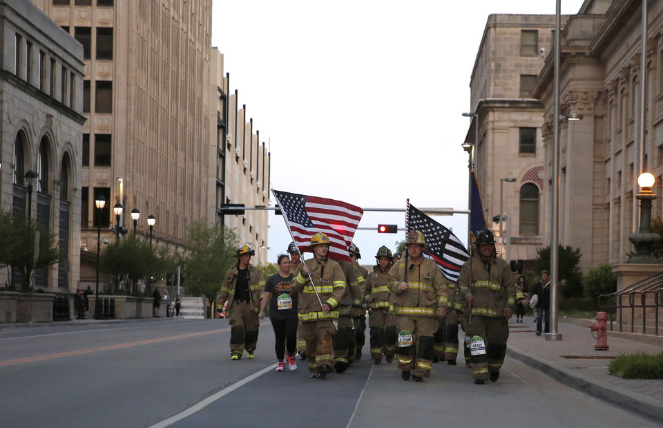 Photo - Firefighters walk during Oklahoma City Memorial Marathon in Oklahoma City, Sunday, April 28, 2019. [Sarah Phipps/The Oklahoman]