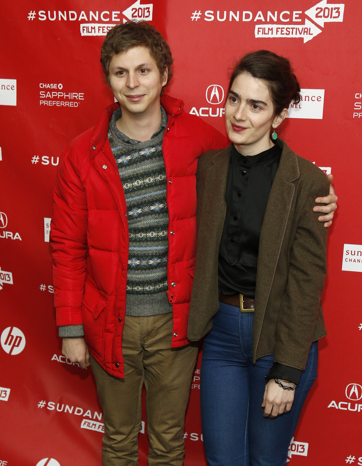 Photo - Cast members Michael Cera, left, and Gaby Hoffmann, right, pose at the premiere of