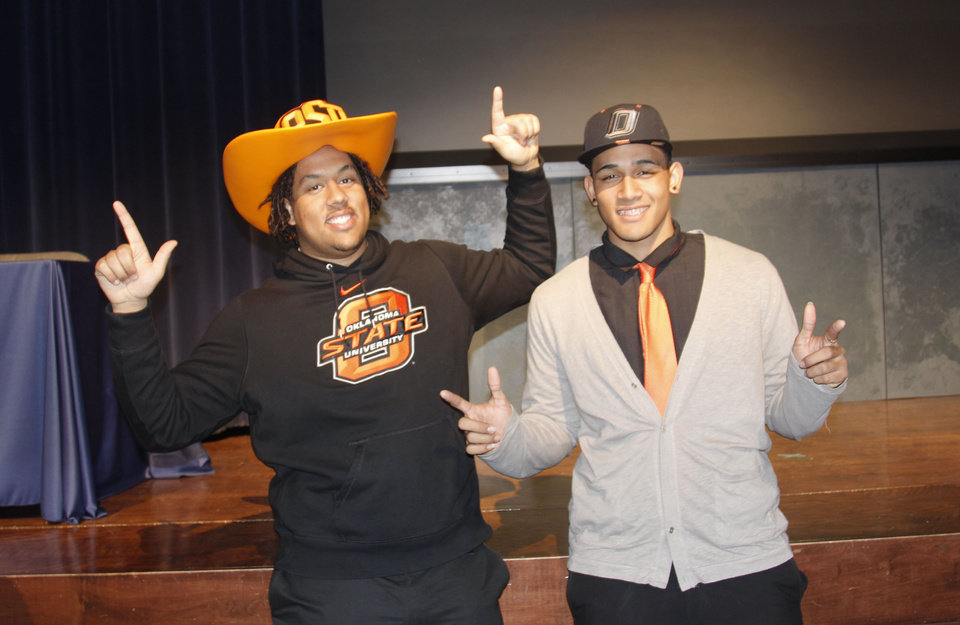 Photo - Jesse Robinson, left, and Vili Leveni celebrate after signing letters of intent with OSU during a signing day ceremony at L.D. Bell High School in Hurst, Texas. PHOTO BY GINA MIZELL, THE OKLAHOMAN