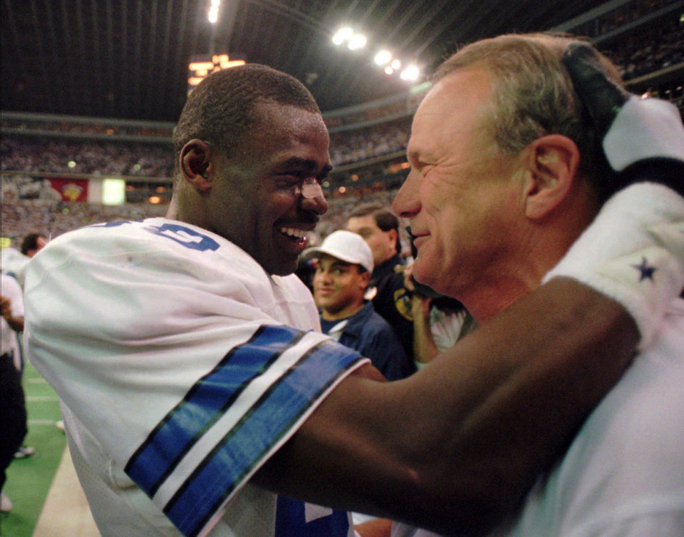 <strong>1996: Switzer and The Playmaker</strong><br>  In this photo from 1996, Switzer and Michael Irvin celebrate a win over Green Bay in the NFC Championship game. AP ARCHIVE PHOTO