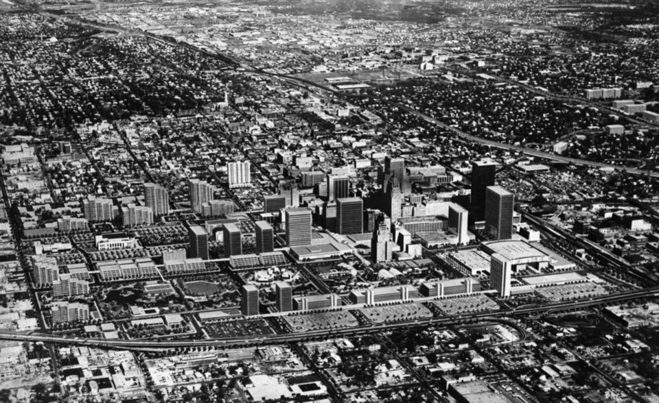 OKLAHOMA CITY / SKY LINE / OKLAHOMA / AERIAL VIEWS / AERIAL PHOTOGRAPHY / AIR VIEWS:  All the buildings aren't there yet, but an artist visualizes the look of Oklahoma City's future.  Copy work by Staff photographer Don Tulious.  Photo dated 11/17/1976 and published on 11/28/1976 in The Daily Oklahoman (SPECIAL).