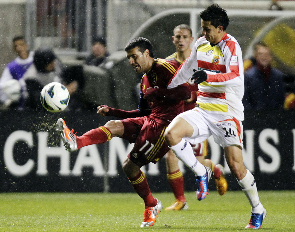 Photo -   Real Salt Lake's Javier Morales, left, fights for control of the ball against C.S. Herediano's Jose Cubero during their CONCACAF soccer match, Tuesday, Oct. 23, 2012, in Sandy, Utah. (AP Photo/The Deseret News, Brian Nicholson) SALT LAKE TRIBUNE OUT; PROVO DAILY HERALD OUT; MAGS OUT