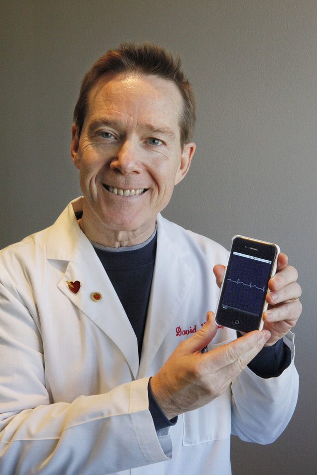 Photo - Dr. David Albert with his EKG app for an iPhone is shown at his office Dec. 30, 2010, in the Research Park in Oklahoma City.  Photo by David McDaniel, The Oklahoman Archives