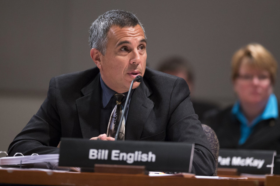 Photo - National Transportation Safety Board (NTSB) lead investigator Bill English answers questions during an NTSB hearing to establish the cause of Asiana Flight 214 airlines crash in San Francisco, and to make safety recommendations, Tuesday, June 24, 2014, in Washington. (AP Photo/ Evan Vucci)