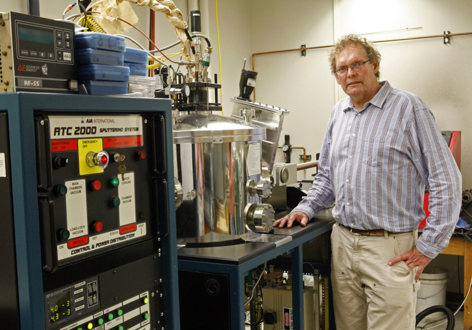 Photo - In this photo taken Monday, June 2, 2014, Kurt Sickfus, a professor at the University of Tennessee, stands with a Magnetron Sputter Coater in Knoxville, Tenn. He is among several researchers involved in efforts to make accident-resistant fuel for the Nuclear industry. (AP Photo/Wade Payne)