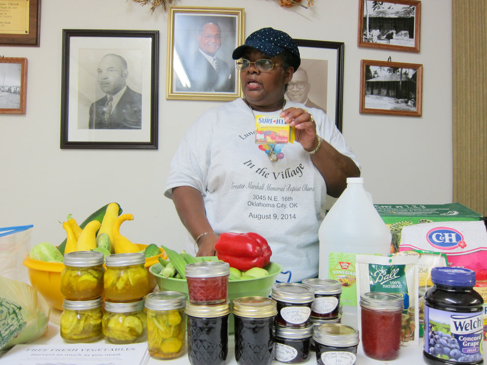 "Photo - Left:  Mary Howard conducts a demonstration about canning and jam and jelly preparation during the ""Lunch and Learn in the Village"" community outreach at Greater Marshall Memorial Baptist Church, 3045 NE 16.  Photos by Carla Hinton, The Oklahoman"