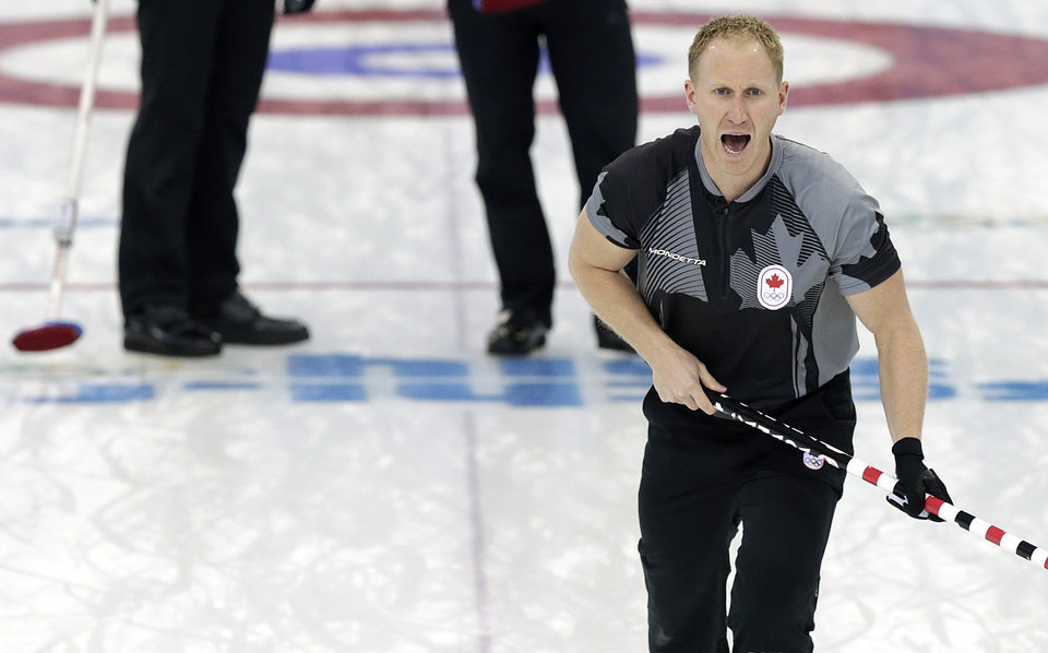 Photo - Canda's skip Brad Jacobs shouts instructions to his teammates during the men's curling gold medal game against Britain at the 2014 Winter Olympics Friday, Feb. 21, 2014, in Sochi, Russia. (AP Photo/Wong Maye-E)