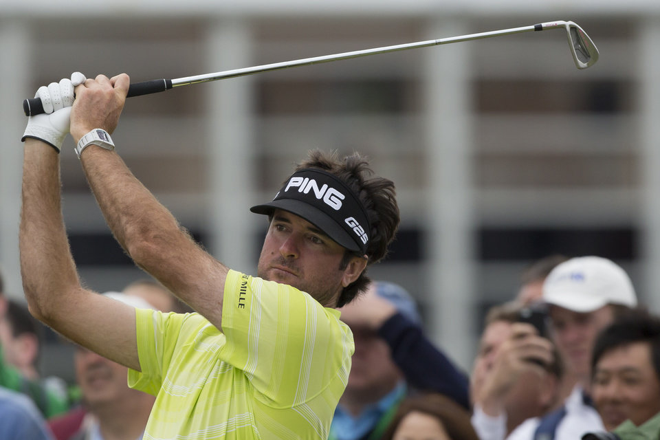 Photo - Bubba Watson of the US plays a shot off the 3rd tee during a practice round at Royal Liverpool Golf Club prior to the start of the British Open Golf Championship, in Hoylake, England, Monday, July 14, 2014. The 2014 Open Championship starts on Thursday, July 17. (AP Photo/Jon Super)