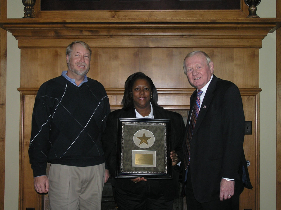 Angie Ransom, of the  Sheraton Midwet City Hotel at the Reed Center, receives the 2008 Oklahoma Hotel & Lodging Association's Outstanding Lodging Employee of the Year Award.  From left: Tim Lyon, Assistant City Manager; Ransom; Joe DePalma Sr, DePalma Hotel Corporation<br/><b>Community Photo By:</b> OHLA<br/><b>Submitted By:</b> Kay, Midwest City