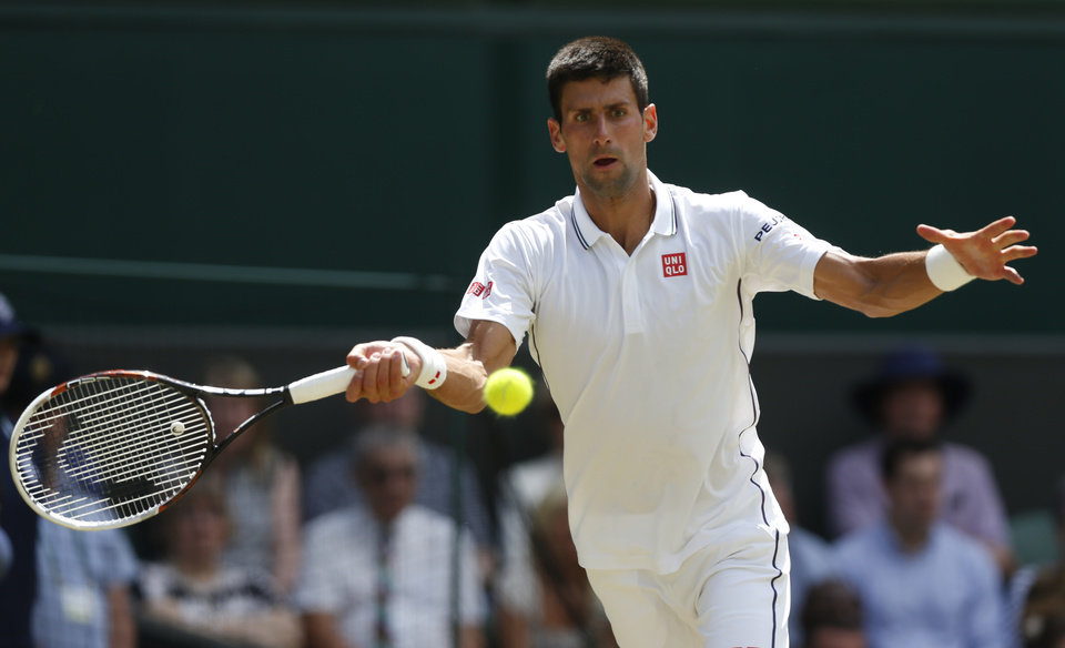 Photo - Novak Djokovic of Serbia plays a return to Gilles Simon of France during their men's singles match at the All England Lawn Tennis Championships in Wimbledon, London, Friday, June 27, 2014. (AP Photo/Sang Tan)