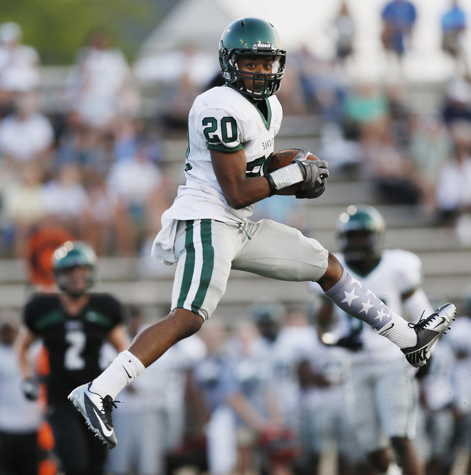 Photo - Edmond Santa Fe's Cameron Westbrook (20) makes a catch during a high school football scrimmage at Moore Stadium between Edmond Santa Fe and Norman North in Moore, Okla., Thursday, Aug. 16, 2012. Photo by Nate Billings, The Oklahoman