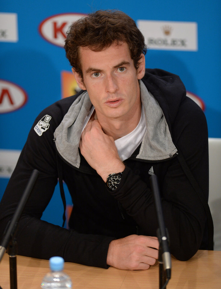 Photo - Britain's Andy Murray answers questions at a press conference following his win over Switzerland's Roger Federer in their semifinal at the Australian Open tennis championship in Melbourne, Australia, Saturday, Jan. 26, 2013. Murray will play Serbia's Novak Djokovic in the final on Sunday Jan 27. (AP Photo/Andrew Brownbill)