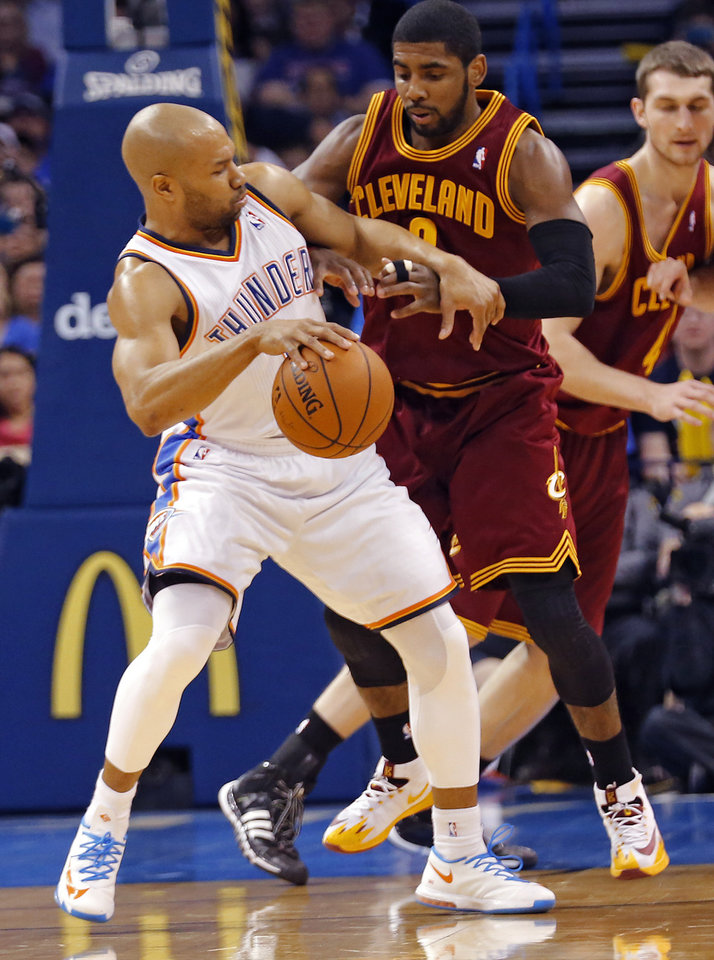 Photo - Cleveland's Kyrie Irving (2) defends on Oklahoma City's Derek Fisher (6) during the NBA basketball game between the Oklahoma City Thunder and the Cleveland Cavaliers at the Chesapeake Energy Arena in Oklahoma City, Okla. on Wednesday, Feb. 26, 2014.  Photo by Chris Landsberger, The Oklahoman