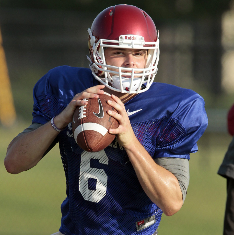 Photo - Quarterback Baker Mayfield goes through drills during the University of Oklahoma Sooners (OU) football practice at the rugby fields in Norman, Okla., on Tuesday, Aug. 5, 2014. Photo by Steve Sisney, The Oklahoman