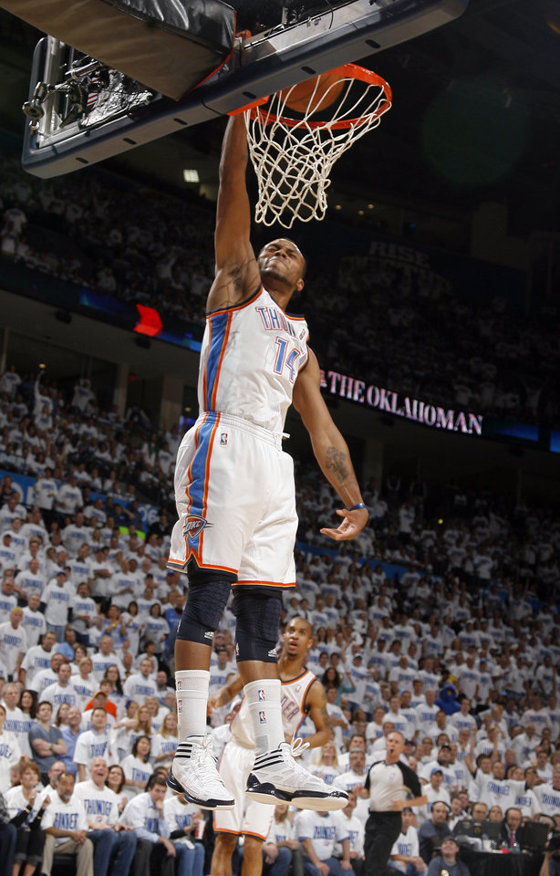 Oklahoma City's Daequan Cook (14) dunks during game five of the Western Conference semifinals between the Memphis Grizzlies and the Oklahoma City Thunder in the NBA basketball playoffs at Oklahoma City Arena in Oklahoma City, Wednesday, May 11, 2011. Photo by Sarah Phipps, The Oklahoman