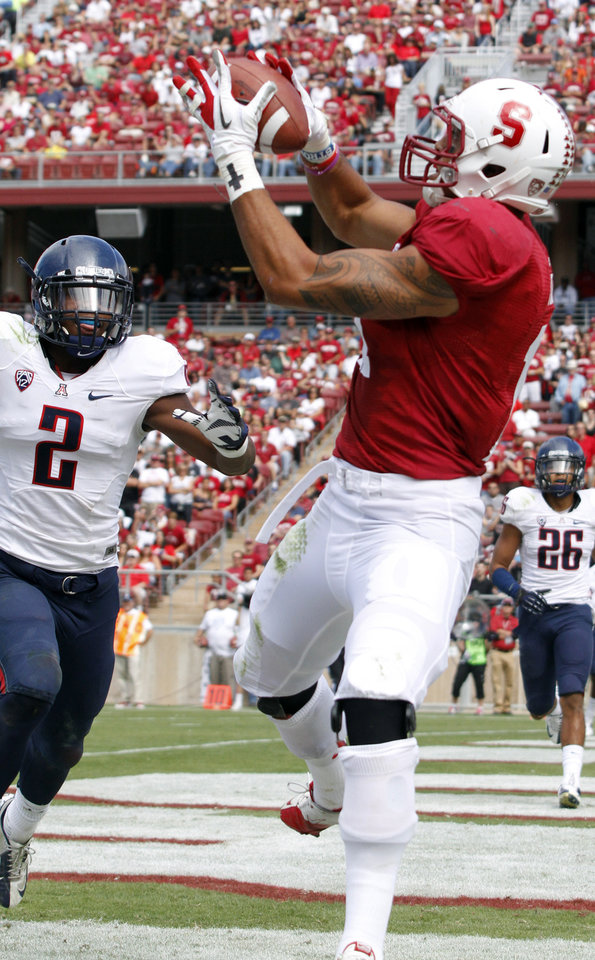Photo -   Stanford's Levine Toilolo makes a touchdown reception in front of Arizona's Kylan Butler (2) during the first half of an NCAA college football game in Stanford, Calif., Saturday, Oct. 6, 2012. (AP Photo/George Nikitin)