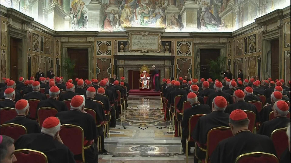 Photo - In this image taken from video as Pope Benedict XVI, seated at centre, delivered his final greetings to the assembly of cardinals at the Vatican Thursday Feb. 28, 2013, before he retires in just a few hours.  Benedict urged the cardinals to work in unity and promised his