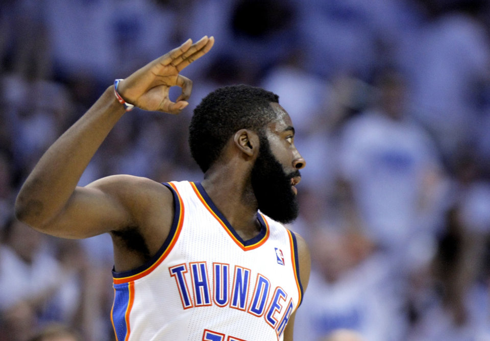 Photo - Oklahoma City's James Harden (13) celebrates a 3-pointer during game five of the Western Conference semifinals between the Memphis Grizzlies and the Oklahoma City Thunder in the NBA basketball playoffs at Oklahoma City Arena in Oklahoma City, Wednesday, May 11, 2011. Photo by Sarah Phipps, The Oklahoman