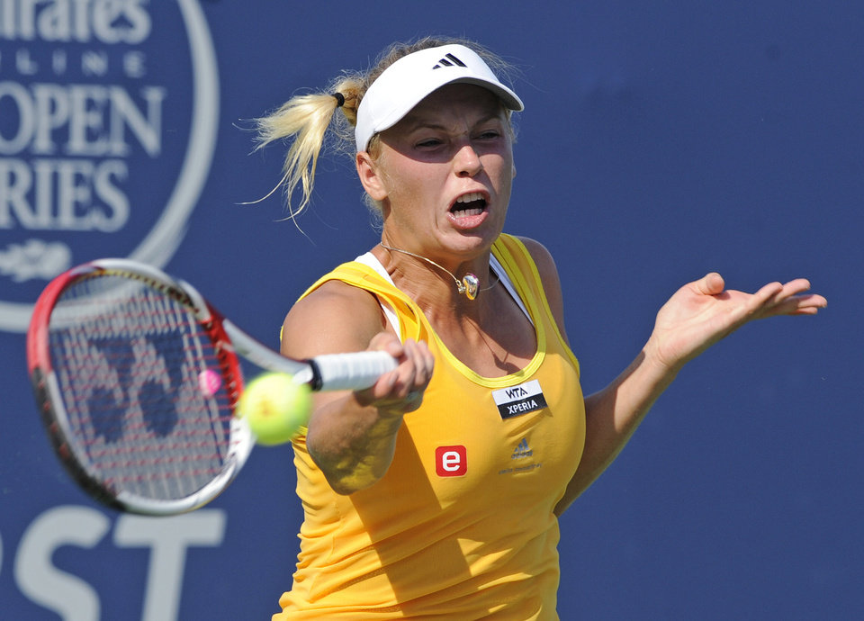 Photo -   Caroline Wozniacki, of Denmark, hits a forehand during her 7-6 (4), 6-2 victory over Sofia Arvidsson, of Sweden, during the New Haven Open tennis tournament in New Haven, Conn., on Wednesday, Aug. 22, 2012. (AP Photo/Fred Beckham)