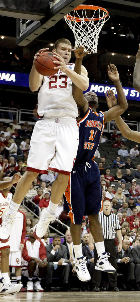 Photo - OU's Blake Griffin grabs a rebound beside Morgan State's Reggie Holmes during a first round game of the men's NCAA tournament between Oklahoma and Morgan State in Kansas City, Mo., Thursday, March 19, 2009.  PHOTO BY BRYAN TERRY, THE OKLAHOMAN
