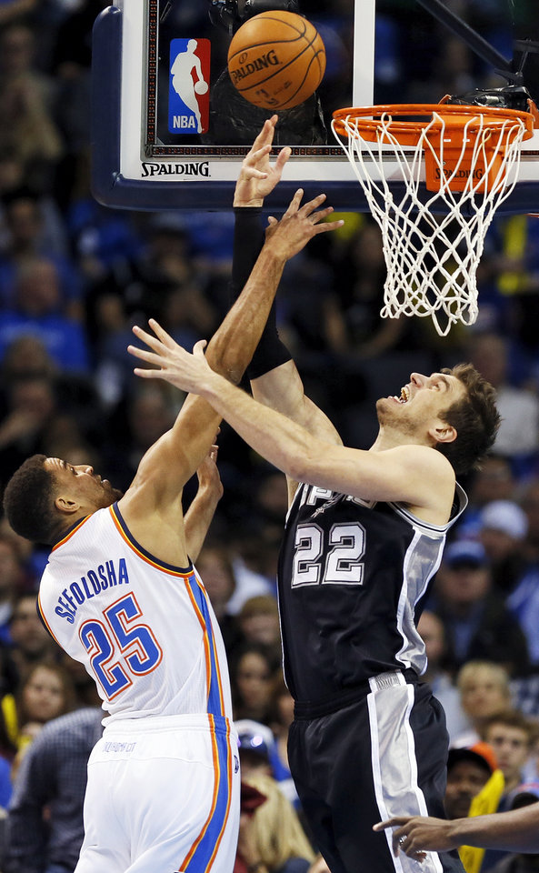 Photo - San Antonio's Tiago Splitter (22) scores against Oklahoma City's Thabo Sefolosha (25) during an NBA basketball game between the Oklahoma City Thunder and the San Antonio Spurs at Chesapeake Energy Arena in Oklahoma City, Wednesday, Nov. 27, 2013. PHOTO BY NATE BILLINGS, The Oklahoman