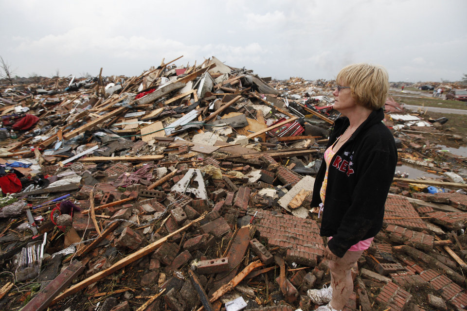 Resident Kim Schwab looks over her destroyed home in south OKC Oklahoma City, OK, Monday, May 20, 2013. Near SW 149th and Hudson.  By Paul Hellstern, The Oklahoman