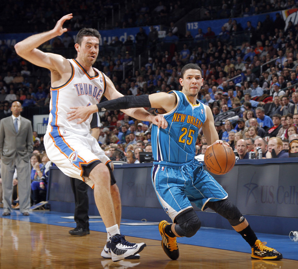 Photo - Oklahoma City Thunder's Nick Collison (4) defends on New Orleans Hornets' Austin Rivers (25) during the NBA basketball game between the Oklahoma CIty Thunder and the New Orleans Hornets at the Chesapeake Energy Arena on Wednesday, Dec. 12, 2012, in Oklahoma City, Okla.   Photo by Chris Landsberger, The Oklahoman