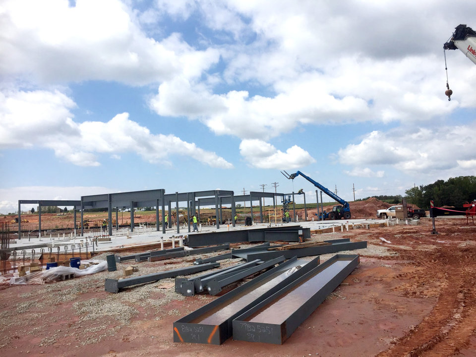 Photo -  Steel is now coming out of the ground at the construction site of Edmond's new hotel and conference center. The project is expected to be completed by Dec. 31, 2017. [PHOTO PROVIDED]