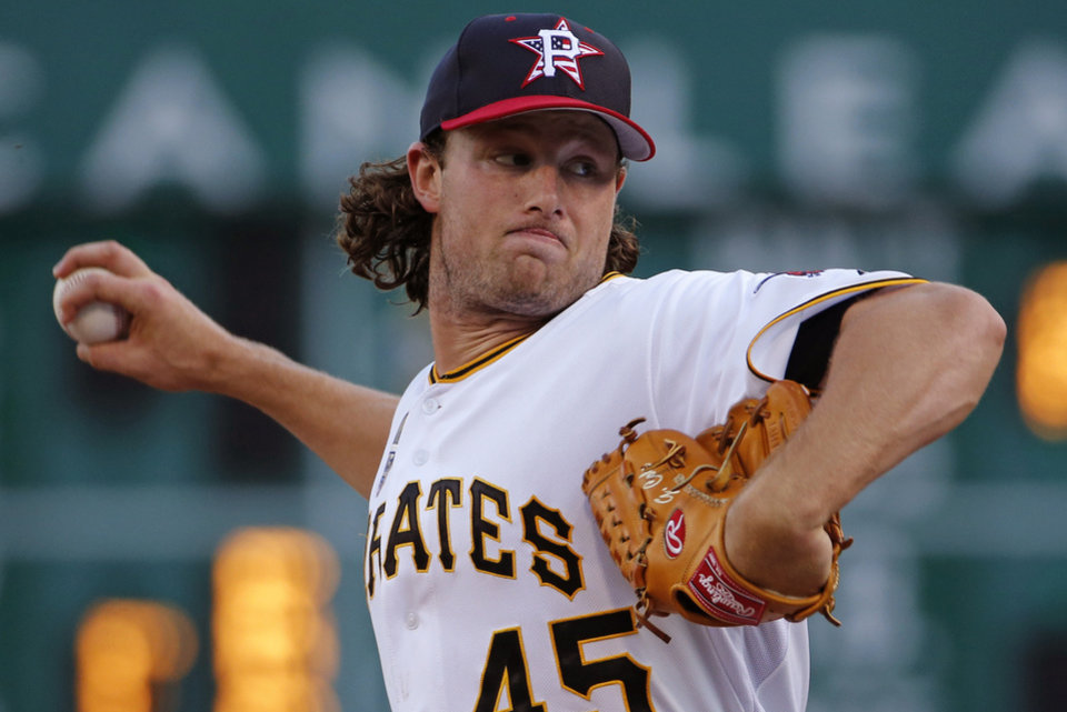 Photo - Pittsburgh Pirates starting pitcher Gerrit Cole warms up before the fifth inning of a baseball game against the Philadelphia Phillies in Pittsburgh, Friday, July 4, 2014. (AP Photo/Gene J. Puskar)