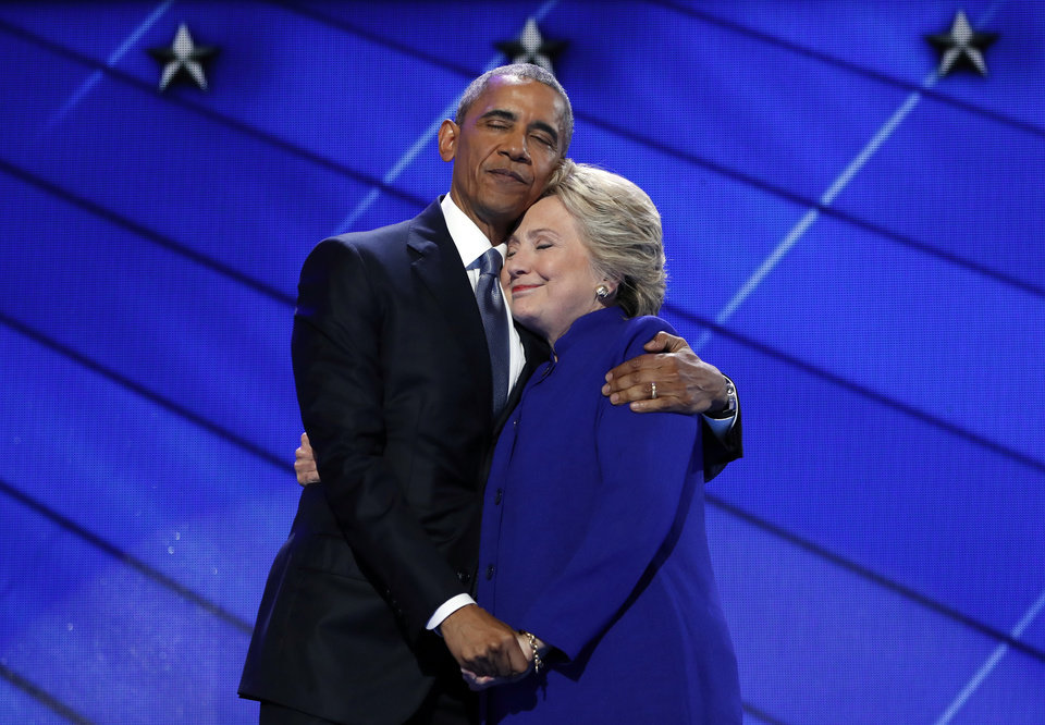 Photo - President Barack Obama hugs Democratic Presidential candidate Hillary Clinton after addressing the delegates during the third day session of the Democratic National Convention in Philadelphia, Wednesday, July 27, 2016. (AP Photo/Carolyn Kaster)