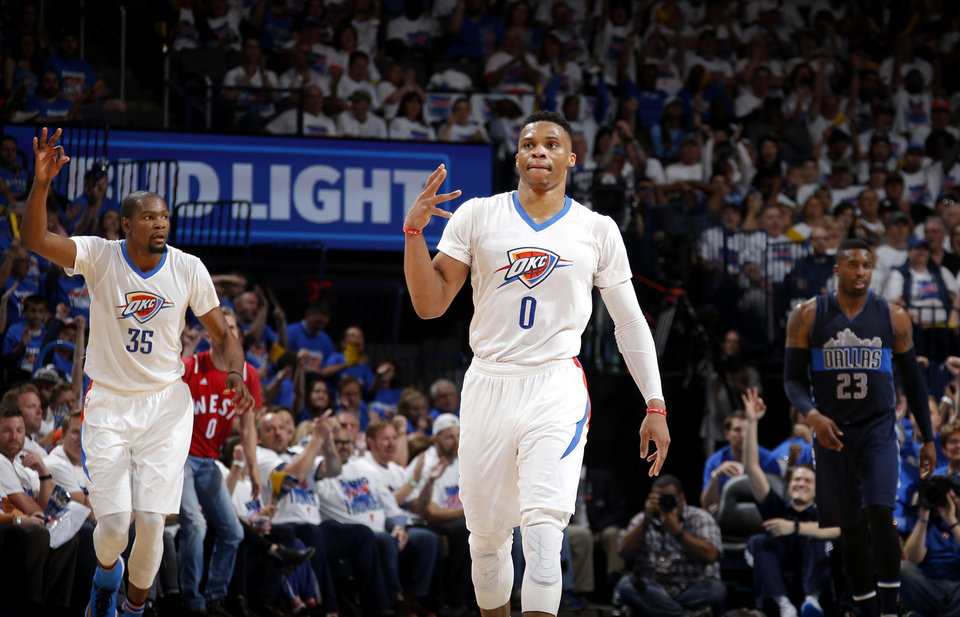 Photo - Oklahoma City's Russell Westbrook and Kevin Durant, left, celebrate a baskey beside Dallas' Wesley Matthews during Game 1 in the first round of the NBA playoffs between the Oklahoma City Thunder and the Dallas Mavericks at Chesapeake Energy Arena in Oklahoma City, Saturday, April 16, 2016. Photo by Bryan Terry, The Oklahoman