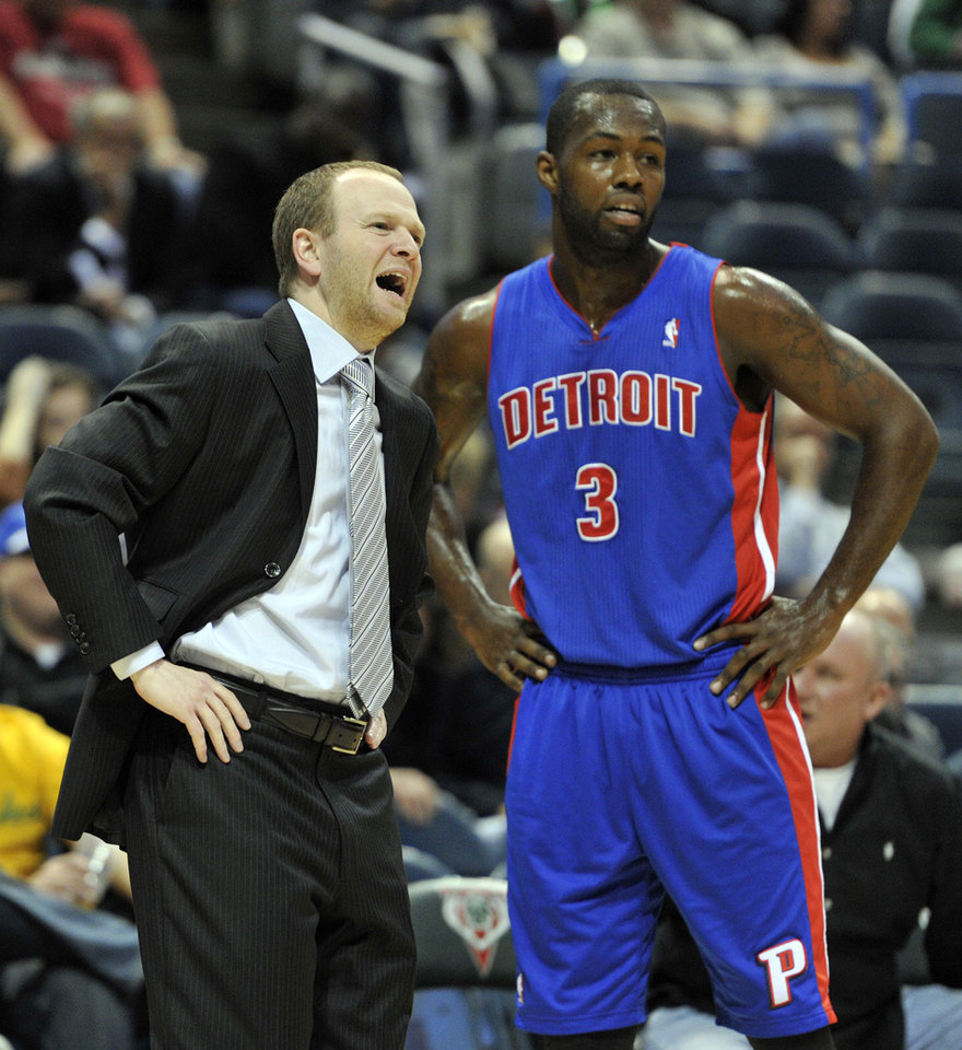 Detroit Pistons head coach Lawrence Frank, left, talks with Rodney Stuckey (3) during an NBA basketball game against the Milwaukee Bucks in the first half on Saturday, Oct. 13, 2012, in Milwaukee. (AP Photo/Jim Prisching)