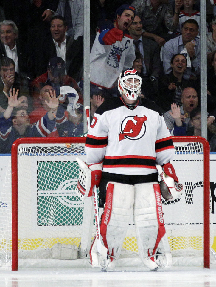 Photo -   New Jersey Devils goalie Martin Brodeur is jeered by New York Rangers fans during the third period of Game 5 of an NHL hockey Stanley Cup Eastern Conference final playoff series, Wednesday, May 23, 2012, in New York. (AP Photo/Frank Franklin II)